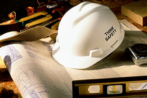 Hard hat and blue prints